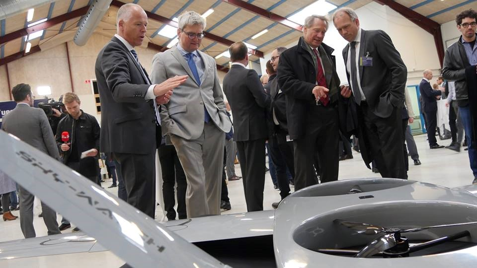 Inside the drone hangar of the University of Southern Denmark, with Henrik Bendixen CEO at Sky-Watch first from the left and Minister of Higher Education and Science, Soren Pind, second from the left.